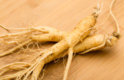 Ginseng. On the wooden background Stock Photo