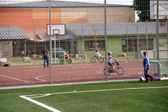 Youth and Sports Park Ginsheim. Ginsheim, Germany - September 23, 2017: Young people and children ride BMX-wheels on a basketball court of the youth and sports Stock Photos