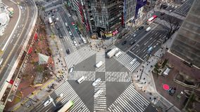 Ginza, Tokyo, Japan- February 6, 2019: 4K aerial time lapse video of People passing the street crossing busy scramble intersection