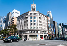 Ginza. Traffic passes by the Wako Department Store in Ginza on September 19, 2013 in Tokyo, Japan Stock Photography