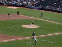 Gio Gonzalez throws pitch with Vernon Wells at 3rd Stock Photos