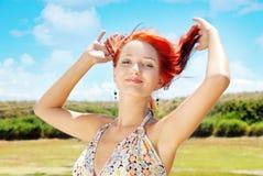 Giocando con i capelli Fotografia Stock