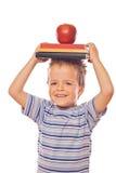 Giocando con i libri e la mela di banco Immagini Stock Libere da Diritti