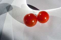 Giocando con i pomodori Fotografia Stock
