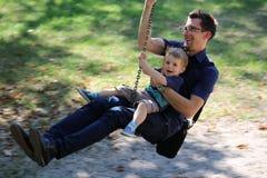 Giocando con il bambino, divertimento Fotografia Stock