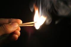Giocando con il fuoco Fotografie Stock Libere da Diritti