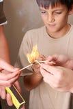 Giocando con il fuoco Fotografie Stock