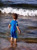 Giocando sulla spiaggia Fotografia Stock