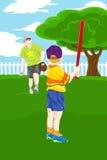 Giocar a baseballe del figlio del padre Fotografie Stock