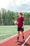 Giocar a calcioe della ragazza Immagini Stock Libere da Diritti