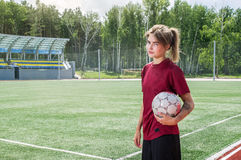 Giocar a calcioe della ragazza Fotografia Stock