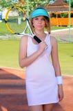 Giocar a tennise Fotografia Stock