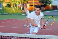 Giocar a tennise Fotografie Stock Libere da Diritti