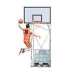 Giocatore che dunking nel cerchio Fotografia Stock Libera da Diritti