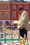 Giocatore dell'insieme di scacchi Fotografia Stock