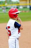 Giocatore della piccola lega sulla base. Fotografia Stock Libera da Diritti