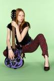 Giocatore di chitarra capo rosso di rock-and-roll Squating Fotografie Stock