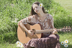 Giocatore di chitarra del Hippie Fotografie Stock