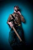 Giocatore di chitarra freddo fotografia stock
