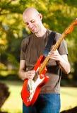 Giocatore di chitarra nel parco Immagine Stock Libera da Diritti