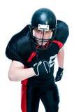 Giocatore di football americano in casco fotografie stock libere da diritti