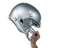 Giocatore di football americano che passa il suo casco del nastro fotografia stock libera da diritti