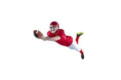 Giocatore di football americano che segna un atterraggio fotografia stock