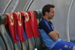 Giocatore di football americano che si siede sul banco Immagini Stock