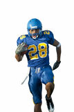 Giocatore di football americano con la sfera Immagini Stock Libere da Diritti