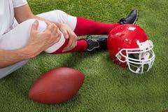 Giocatore di football americano danneggiato fotografie stock libere da diritti