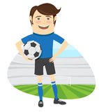 Giocatore di football americano divertente di calcio che indossa holdi diritto della maglietta blu Immagini Stock