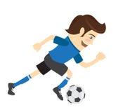 Giocatore di football americano divertente di calcio che indossa il kickin corrente della maglietta blu Fotografia Stock