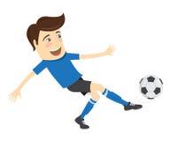 Giocatore di football americano divertente di calcio che indossa il kickin corrente della maglietta blu Fotografie Stock