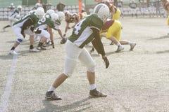 Giocatore di football americano durante il gioco fotografie stock
