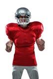 Giocatore di football americano irritato in jersey rosso che grida immagini stock