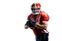 Giocatore di football americano nel bianco di azione isolato fotografia stock