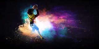 Giocatore di football americano nell'azione Media misti immagini stock libere da diritti