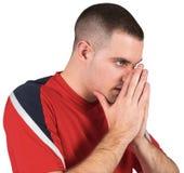 Giocatore di football americano nervoso che guarda avanti fotografia stock