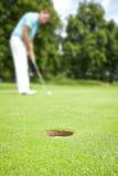 Giocatore di golf fotografie stock