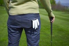 Giocatore di golf dalla parte posteriore con il guanto Fotografia Stock Libera da Diritti