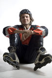 Giocatore di hokey che si siede fornito di gambe trasversale - verticale Immagini Stock Libere da Diritti