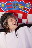 Giocatore di hokey del ghiaccio con la bandierina croata Immagini Stock