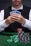 Giocatore di poker su una striscia di conquista immagine stock