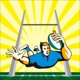 Giocatore di rugby che si tuffa al segno Immagine Stock