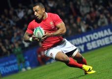 Giocatore di rugby del Tonga con la palla Immagini Stock Libere da Diritti