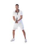 Giocatore di tennis maschio nell'azione Immagini Stock