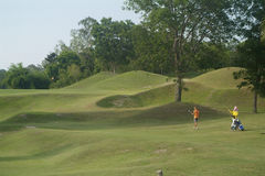 Giocatore e caddie di golf Fotografia Stock