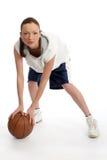Giocatore femminile della sfera del cestino Fotografie Stock