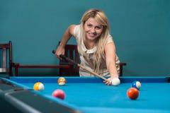Giocatore femminile dello stagno Fotografia Stock