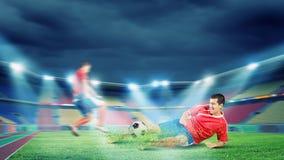 Giocatori di football americano Fotografie Stock
